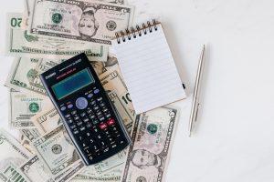 cash, notebook and calculator